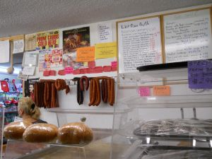 The various kielbasa hang from the store's wall.